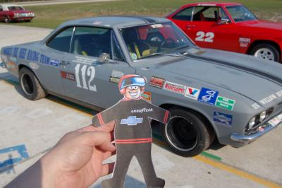 Flat Stanley with Corvair: Flat Stanley poses with Corvair he will be racing in.