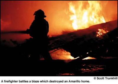 Firefighers battle a house fire in Amarillo, Texas